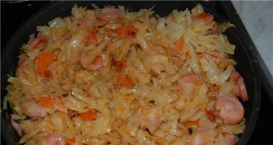 Solyanka (stewed cabbage) with sausages