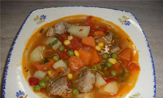 Thick soup with corn, peas and pumpkin