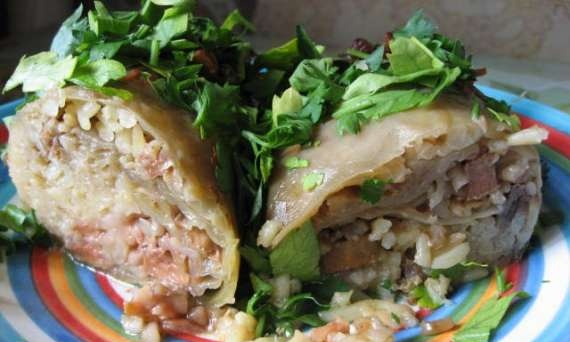 Cabbage rolls with rice, meat and quince