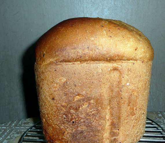 Wheat bread on kefir with cheese in a bread maker