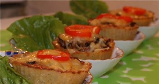 Dough baskets for potato pancakes with mushroom filling and cheese