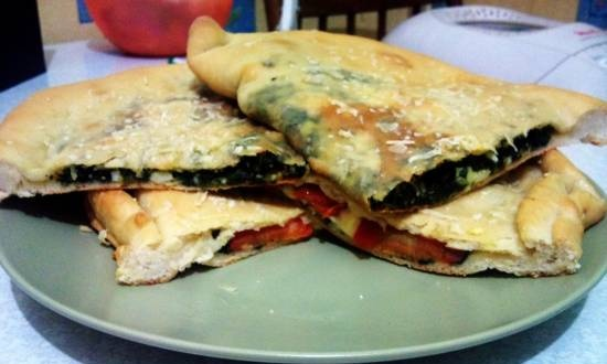 Closed pizza with spinach