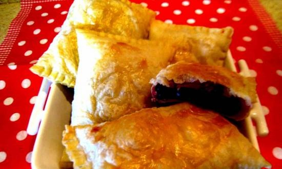Puff pastries with frozen cherries in the oven