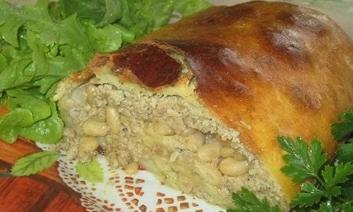 Meatloaf with beans and cabbage in dough