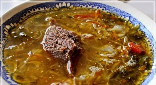 Sour cabbage soup from sauerkraut with goose