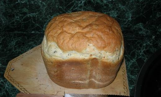 Spicy bread with garlic and herbs in a bread maker