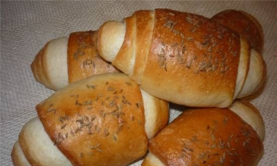 """""""Arrows"""" with caraway seeds on a thick dough"""