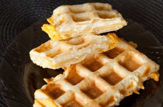 Puff pastry waffles in a waffle iron