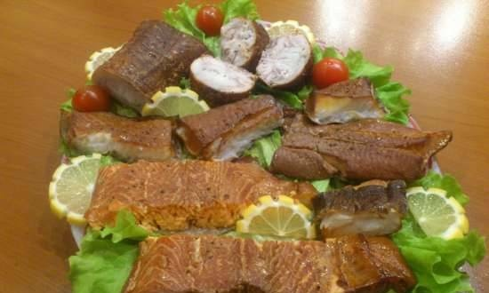 Smoked halibut, salmon and catfish in a smokehouse with a water seal