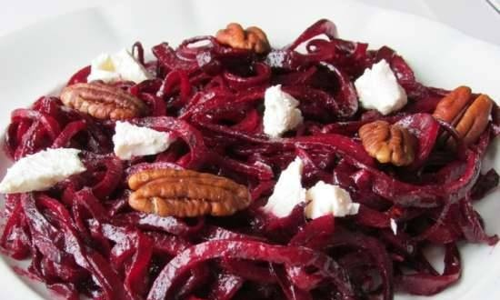 Beet spaghetti with goat cheese and pecans