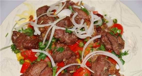 Baked pieces of lamb with vegetables