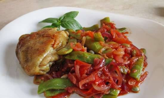 Green beans fried with onions and tomatoes