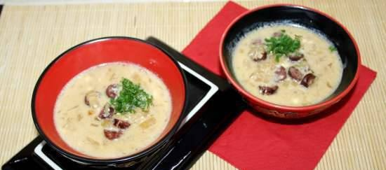Bavarian beer soup with cheese and smoked sausages