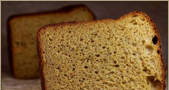 Wheat-rye bread with carrots and caraway seeds in sourdough