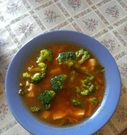 Tomato soup with broccoli and garlic arrows