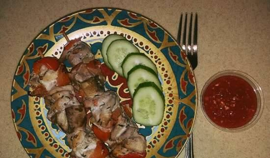Chicken fillet skewers with vegetables in red wine, baked in the oven