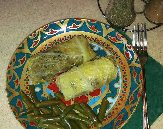 Savoy cabbage cabbage rolls with celery on a green bean pillow in a multicooker Redmond RMC-M 4502