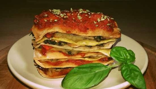 Whole wheat lasagna with tomato, celery and basil sauces in the oven