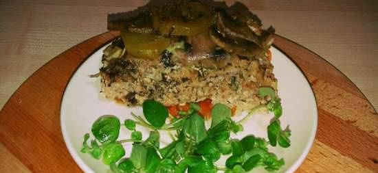 Ground turkey casserole with vegetables, mushrooms and oregano in a ceramic pot in the oven