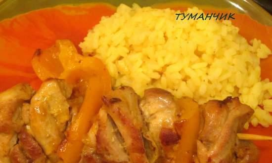 Chicken skewers in tangerine sauce with rice