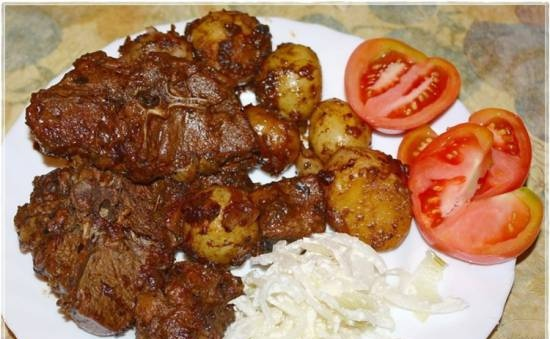 Lamb with fried potatoes in a cauldron