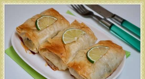 Fillet of fish (pollock) in filo dough diapers, stuffed with herbs, egg and butter in a Princess pizza maker or oven