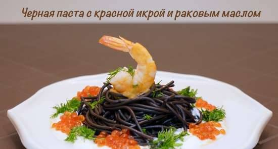 Black pasta with red caviar and crayfish oil under sour cream sauce