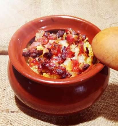 Bulgur stewed in a pot with bacon and truffle oil