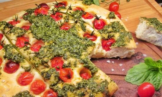 Focaccia with pesto sauce and cherry tomatoes