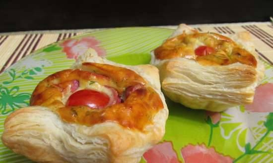 Puffs of ready-made dough with juicy cheese and sausage filling