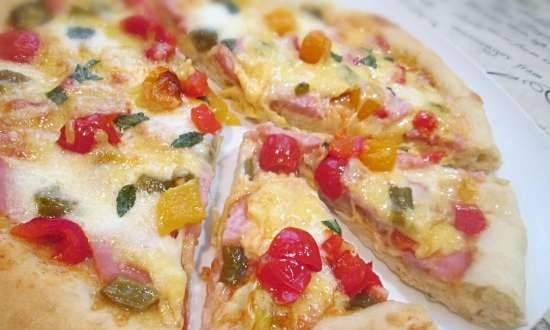 Pizza with baked peppers and ham