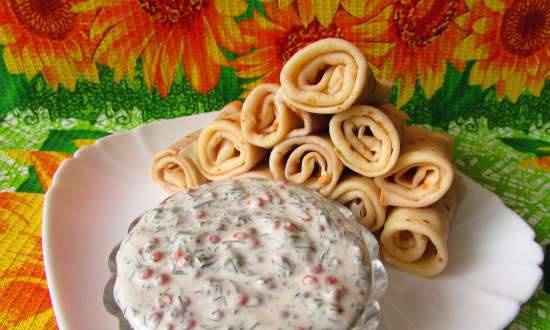 Sour cream sauce with red caviar for pancakes