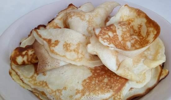 Thin pancakes with curdled milk