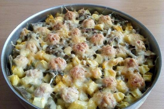 Vegetable stew with fish balls and cheese crust