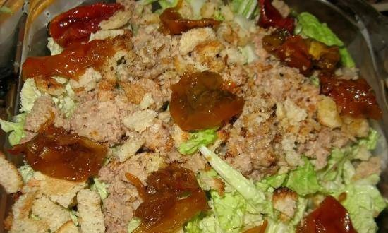 Peking cabbage salad with cod liver, sun-dried tomatoes and croutons
