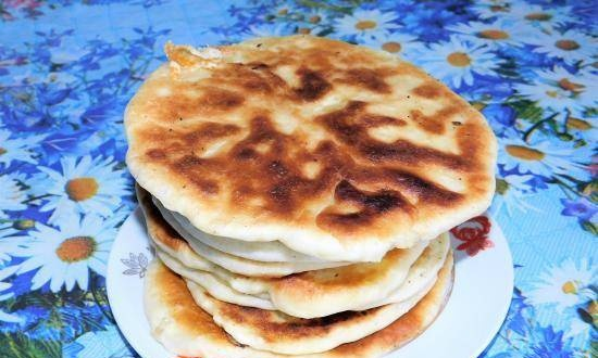 Quick cakes on kefir with eggs and suluguni (or with any other filling)