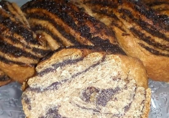 Braid with poppy seeds and raisins made from 100% whole grain yeast dough with soda water