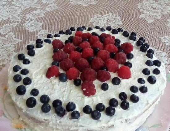 Just a biscuit and a cake based on it with curd soufflé and berries (healthy food)