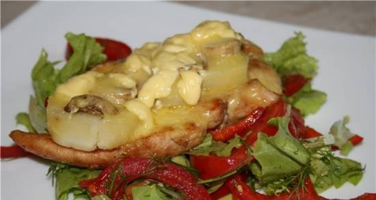 Fillet baked with potatoes and mushrooms