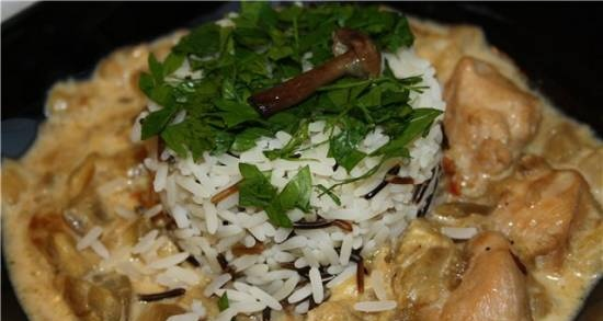Chicken stewed with eggplant in cheese and sour cream sauce
